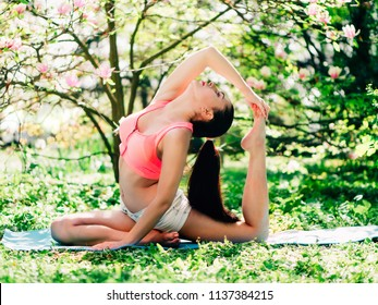 Young sport woman exercising - outside in nature