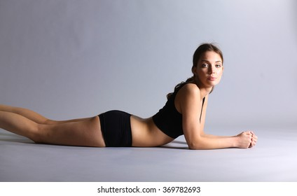 A young sportive girl lying on the floor