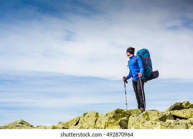 Young sportive hiker trekking in the mountains. Sport and active life concept