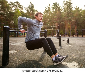 Young sports athlete fitness. Exercise Parallel Bars Outdor. Sport, workout, gym, exercising, training and lifestyle concept.