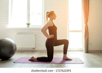 young sports girl do sports at home on the mat in sportswear, sportswoman does exercise on the press in the morning in the room, self-isolation concept
