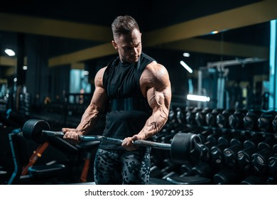young sportsman bodybuilder have workout and exercising with barbell in gym