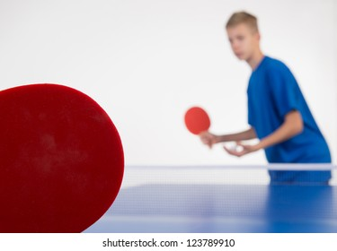 Young sportsman playing table tennis