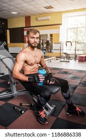 young sportsman resting after training with protein coktail