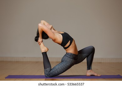 Young sportswoman doing stretching exercises
