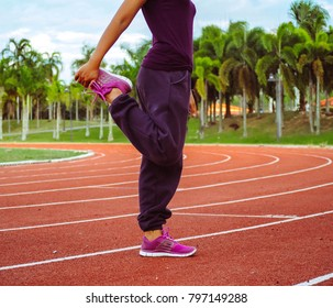 Young sportswoman stretching and preparing to run, woman worm up body