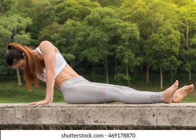 Young sportswoman stretching and preparing to yoga