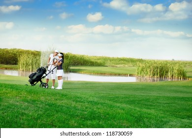 Young sporty couple playing golf on a golf course