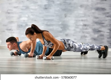 Young sporty couple training in gym