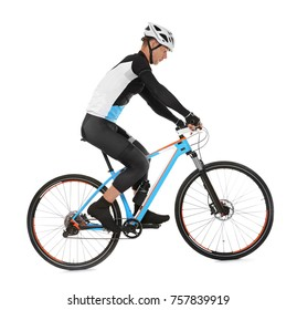 Young sporty cyclist riding bicycle on white background