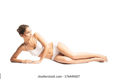 Young, sporty, fit and beautiful girl isolated on white