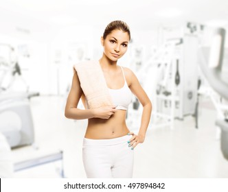 Young, sporty, fit and beautiful girl in the gym