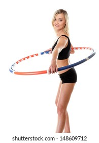 young sporty girl doing exercise with hula hoop. Fitness woman isolated on white