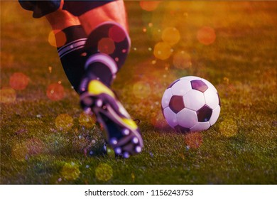 Young sporty man in uniform play soccer