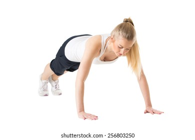 Young sporty woman doing push-ups and exercising