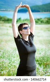 Young sporty woman in field
