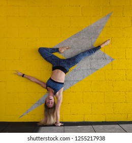 Young sporty woman portrait working out in the gym upside down. Concept of active lifestyle.