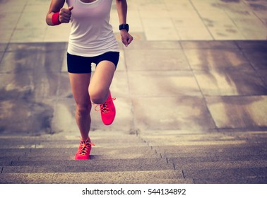 young sporty woman running on mountain stairs