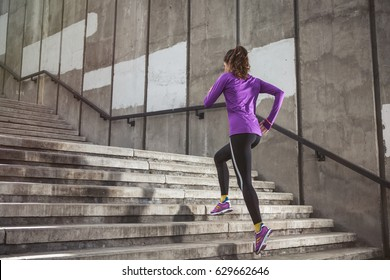young sporty woman running upstairs