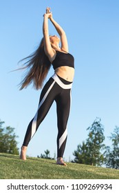 Young sporty woman stretching before the trainig outdoors.
