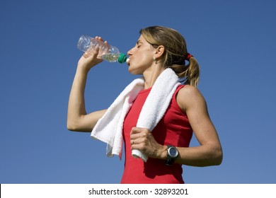 Young sporty women drinking water