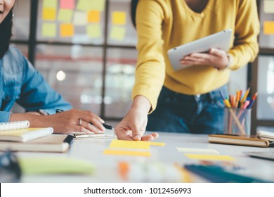 Young startups business people teamwork brainstorming meeting. Business teamwork and education concept. Select focus at hand holding pen.
