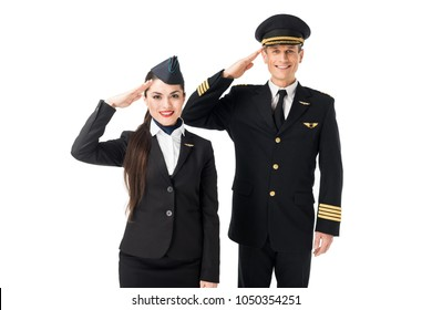 Young stewardess and pilot saluting isolated on white