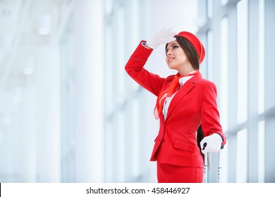 Young stewardess in uniform indoors