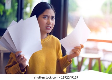 Young stressed business woman feeling disappointed when colleague gave many paperwork to review content before submission to leader, management to sign. Anger feel angry coworker from overload task.