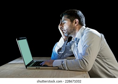 young stressed businessman working with computer laptop in frustration, depression, work stress problems and despair concept isolated on black background