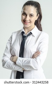 Young strict brunette in a white shirt with a tie
