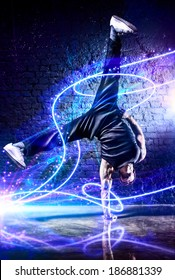 Young strong man break dance. With light effects.