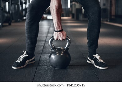 Young strong man during training in the gym