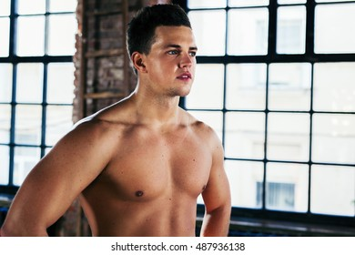 Young strong man indoors portrait