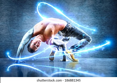 Young strong man. With iron hands and light effects.