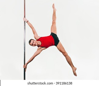 Young strong pole dance man doing iron x