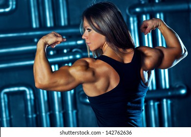 Young strong sports woman portrait.