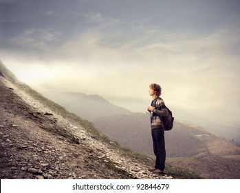 Young student about to climb a hill