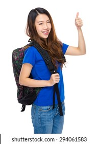 Young student with backpack and thumb up gesture