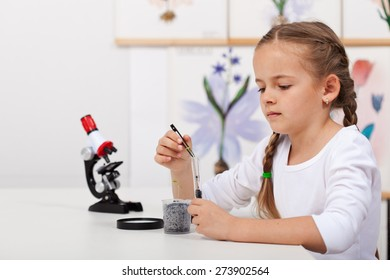 Young student in biology science class study small plants growth