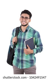 A young student carrying his backpack and books, isolated on a white background.