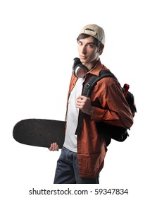 Young student carrying a skateboard and a rucksack