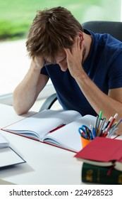 Young student depressed and tired before hard examination