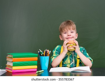 Young student eating a sandwich at lunchtime