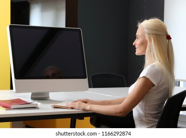 Young Student Girl is Studying with Computer