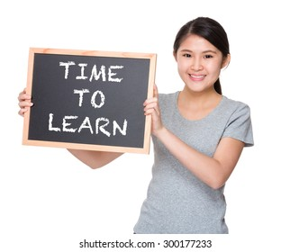 Young student hold with black board showing phrase time to learn