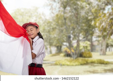 young student kiss indonesia flag on independence day
