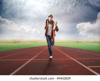 Young student running on a racing track