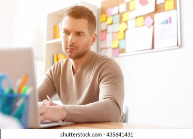 Young student studying at home