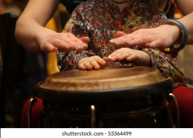 Young student and teacher at drum class